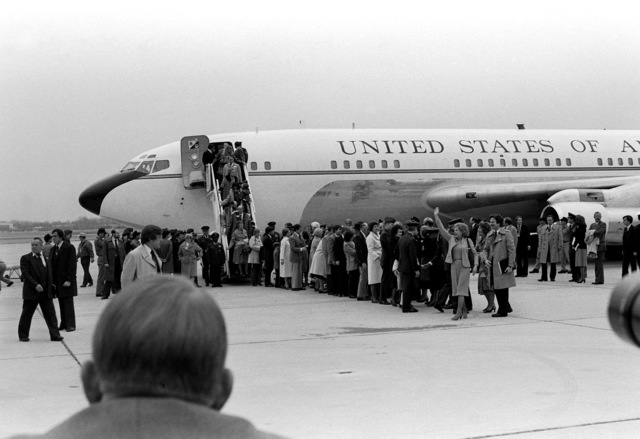 Americans recently released from Iran, where they were held hostage, and their families disembark from Freedom One, an Air Force VC-137 Stratoliner aircraft