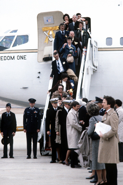 Former Iranian hostages and their families disembark their plane upon their arrival