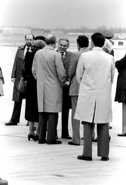 Secretary of State Alexander Haig, facing the camera, greets the Americans formerly held hostage and recently released by Iran upon their arrival at the base