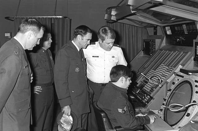 A major and a sergeant explain the operation of an en route radar indicator to GEN Charles A. Gabriel, commander in chief, U.S. Air Force Europe; COL Frye, base commander, Tempelhof Central Airport; and COL Musmanno, commander, 1946th Communications Squadron