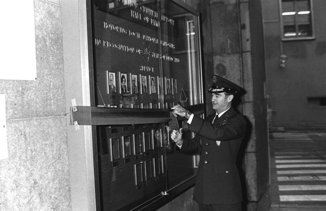 GEN Charles A. Gabriel, commander in chief, U.S. Air Force Europe, cuts the ribbon at a ceremony at Tempelhof Central Airport dedicating a Hall of Fame for local national employees who have been employed by the military in Berlin for 35 years