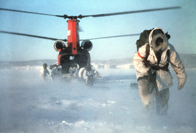 Army personnel leave a C-47 Chinook helicopter at Clear Creek Landing Zone, Alaska, during exercise Brim Frost '81