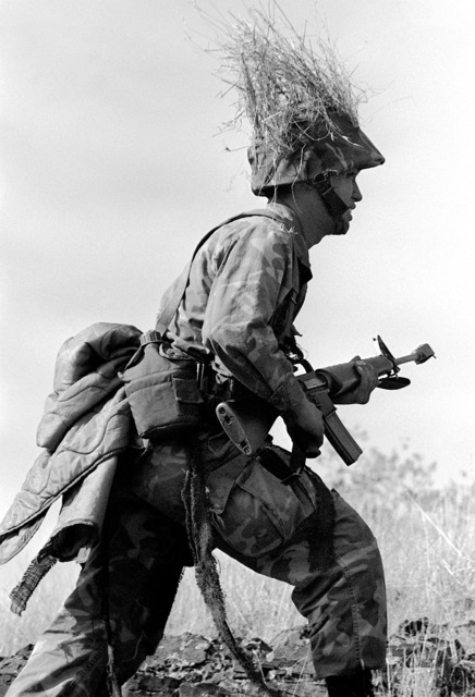 A combat-ready Marine from 1ST Plt., Co. C, 1ST Bn., 1ST Marines, 1ST Mar. Div., runs to line up with the rest of his squad during an assault on their objective