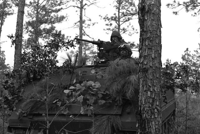 A South Carolina National Guardsman sits in his M-113 armored personnel carrier in support of an ambush during a field exercise