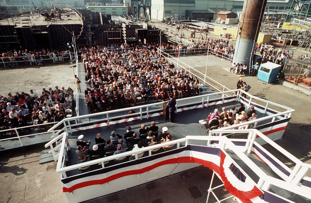Elevated view of the speakers platform and the guests attending the launching ceremony for the guided missile frigate MAHLON S. TISDALE (FFG-27) at Todd Pacific Shipyard