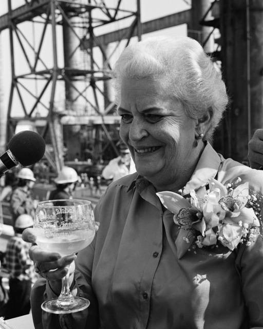 Mrs. Kenneth J. Sanger, sponsor, enjoys refreshments during the launching ceremony for the guided missile frigate MAHLON S. TISDALE (FFG 27) at Todd Pacific Shipyards