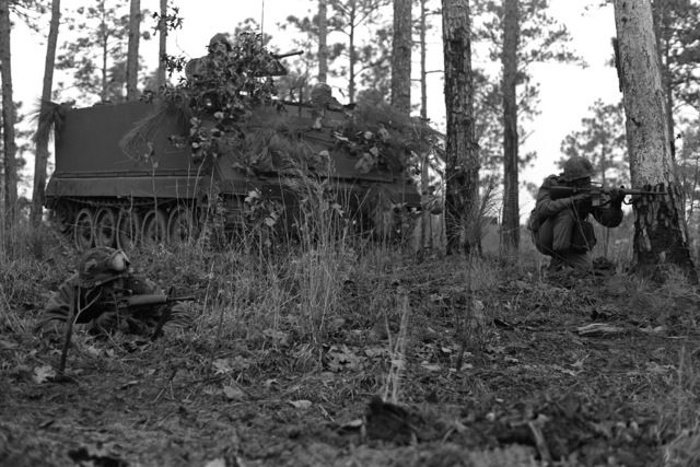 SGT. John Glen and SPEC. 4 Olin of the South Carolina Army National Guard, set up an ambush with the support of an M-113 armored personnel carrier positioned behind them