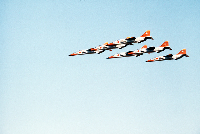A left side view of six T-2 Mitsubishi jet trainer aircraft flying in formation during an air show. Within the next year, the T-2 aircraft will replace the F-86F Sabre aircraft that are presently flown by the Japanese Blue Impulse Precision Flying Team