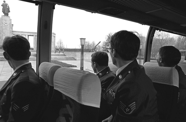 U.S. Air Force Europe outstanding airmen watch a change of German guards at the Soviet memorial from a bus during a tour of West Berlin