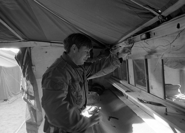 A member of the 554th Civil Engineering Squadron wires a latrine that will be used during Exercise Team Spirit '81