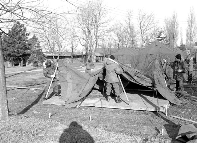 Members of the 554th Civil Engineering Squadron erect tents that will be used to house participants in Exercise Team Spirit '81