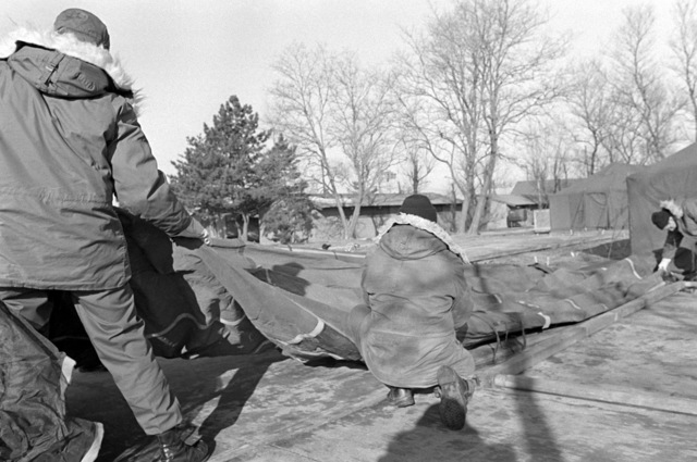 Members of the 554th Civil Engineering Squadron lay out tents that are being constructed, as preparations are made for Exercise Team Spirit '81