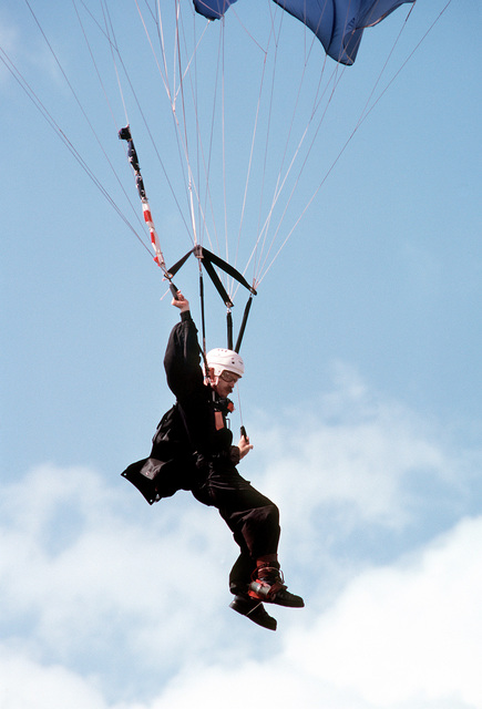 A member of the 193rd Command Parachute Team displays his skill in a free fall jump from a C-130 Hercules aircraft during exercise Black Hawk IV