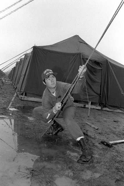 AMN Mike Dempsey, Red Horse Team, 554th Civil Engineer Squadron, helps put up tents during the Joint Chiefs of STAFF Exercise Team Spirit '81