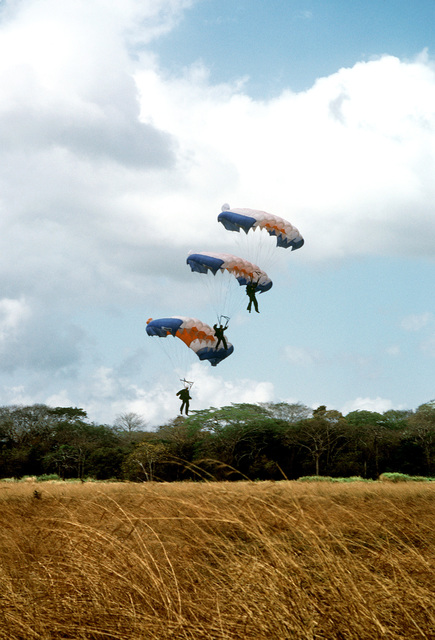 Free fall jumpers of the 193rd Command Parachute Team are about to land during exercise Black Hawk IV