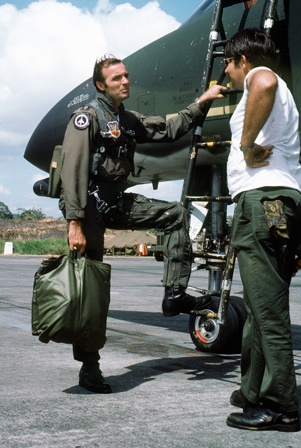 MAJ Strangler, an F-4 Phantom II aircraft pilot, speaks to his crew chief about the readiness of the aircraft