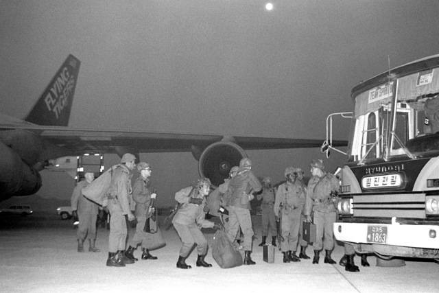 U.S. Army soldiers are airlifted to Osan by the Flying Tiger Airlines for participation in the Joint Chiefs of STAFF Exercise Team Spirit '81. The soldiers leave the air station on a public transportation bus
