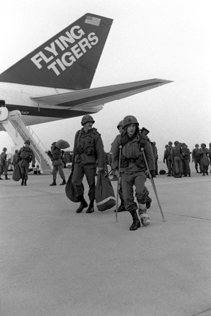 U.S. Army soldiers are airlifted to Osan by the Flying Tiger Airlines for participation in the Joint Chiefs of STAFF Exercise Team Spirit '81. A soldier arrives on crutches to take part in the exercise