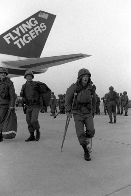 U.S. Army soldiers are airlifted to Osan by the Flying Tiger Airlines for participation in the Joint CHIEF of STAFF Exercise Team Spirit '81. A soldier arrives on crutches to take part in the exercise