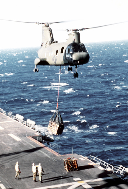 Marine Corps CH-46 Sea Knight helicopter from HMM (C) Squadron-265, makes an external airlift of supplies from the amphibious assault ship, USS TARAWA (LHA-1), to one of the Marine units ashore. Marines from 1ST Bn., 3rd Marines, 3rd Mar. Div., Fleet Marine Force, (BLT 1/3), and the 31st Marine Amphibious Unit (31st MAU) are participating in operation Valiant Usher 1-81-A