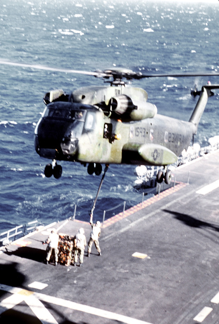 Marine Corps CH-53D Sea Stallion helicopter from HMM (C) Squadron-265, prepares to make an external airlift of supplies from the amphibious assault ship USS TARAWA (LHA-1). This airlift is part of Operation Valiant Usher 1-81-A