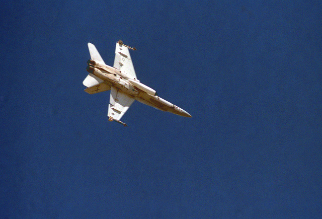 A underside view of an F/A-18 Hornet aircraft assigned to Air Test and Evaluation Squadron Four (VX-4)
