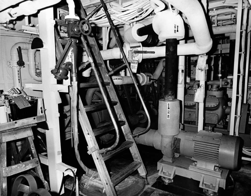 An interior view of the air conditioning machinery room on the guided missile frigate USS ANTRIM (FFG 20) at 90 percent completion