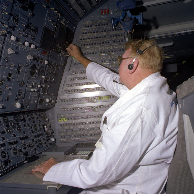 A civilian employee from McDonnell Douglas Corp. performs tests at the flight engineer's station aboard a KC-10A Extender aircraft