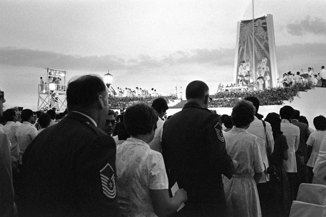 Two Air Force families receive holy communion from Pope John Paul II (background) during the Beatification Mass Ceremony