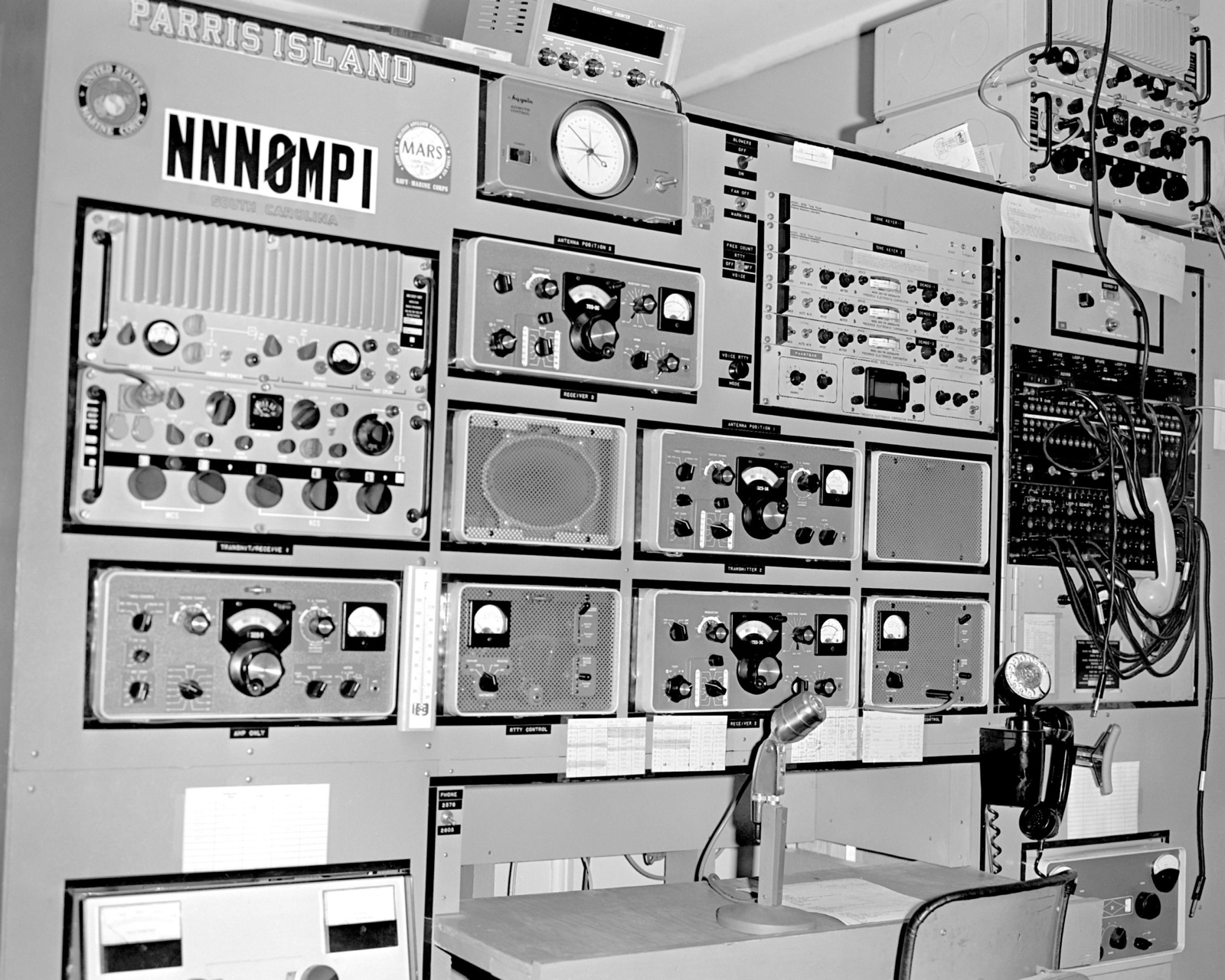 A wide angle view of the control console, including a URC-35 transmitter/receiver, part of the equipment located at the Military Affiliate Radio System (MARS) station