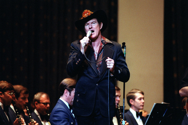 A guest country music singer makes an appearance with the U.S. Air Force band during a concert at D.A.R. Constitution Hall