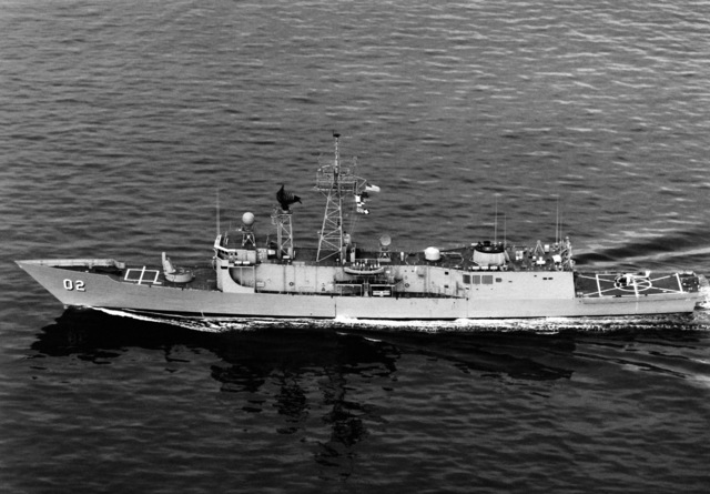 An aerial port beam view of the Australian frigate CANBERRA (F-02) underway