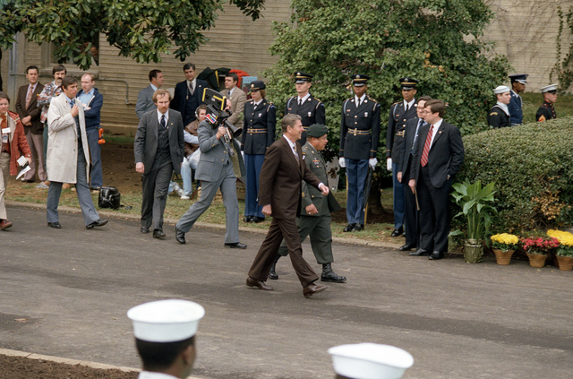 President Ronald Reagan arrives at the Pentagon for a Medal of Honor award ceremony. Walking beside him is the recipient, retired MSGT Roy P. Benavidez, U.S. Army