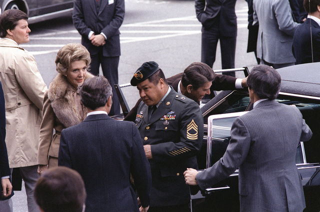 President Ronald Reagan, beside the car, and Medal of Honor recipient, retired MSGT Roy P. Benavidez, U.S. Army, arrive at the Pentagon for the award ceremony