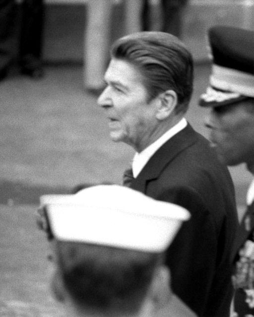 President Ronald Reagan, center, leaves the Pentagon at the conclusion of the Medal of Honor award ceremony for retired MSGT Roy P. Benavidez, U.S. Army