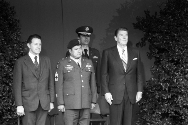 President Ronald Reagan, right, and Medal of Honor recipient, retired MSGT Roy P. Benavidez, U.S. Army, stand during the award ceremony at the Pentagon