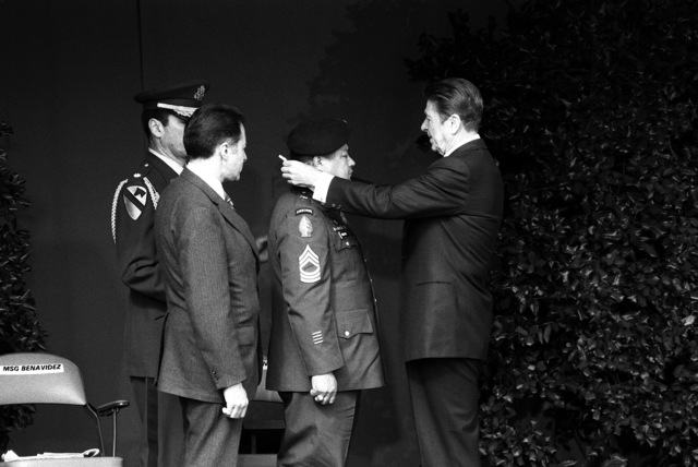 President Ronald Reagan, right, presents retired MASTER SGT. Roy P. Benavidez, U.S. Army, with the Medal of Honor during the ceremony at the Pentagon