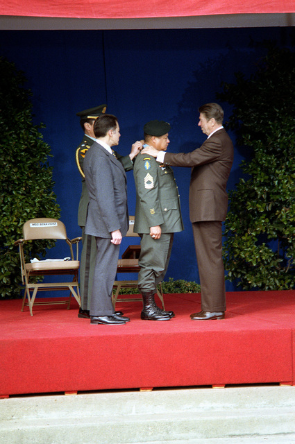 President Ronald Reagan, right, presents retired MASTER SGT. Roy P. Benavidez, U.S. Army, with the Medal of Honor during a ceremony at the Pentagon