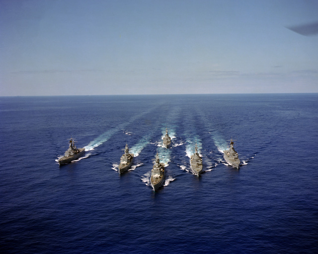 An aerial bow view of six nuclear-powered guided missile cruisers underway in formation during Exercise READEX 1-81. The ships are, from left to right: USS TEXAS (CGN 39), USS CALIFORNIA (CGN 36), USS SOUTH CAROLINA (CGN 37), USS VIRGINIA (CGN 38), USS ARKANSAS (CGN 41) and USS MISSISSIPPI (CGN 40), background