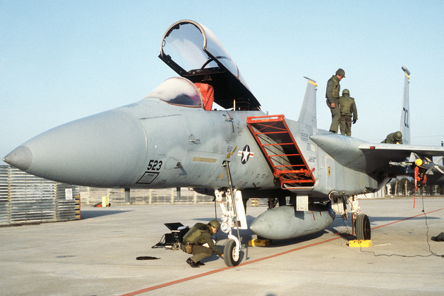 8th Component Repair Squadron members check an F-15 Eagle aircraft during exercise Team Spirit '81