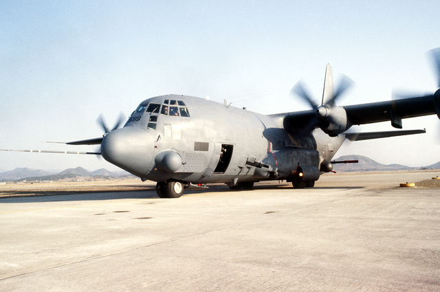 A front view of an AC-130H Hercules aircraft after engine start during Exercise Team Spirit '81