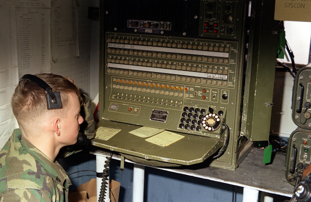 A Marine corporal of Marine Aircraft Group 12 (MAG-12) operates a cordless telephone switchboard, SB-3082 (V) 2/GT, during exercise Team Spirit '81
