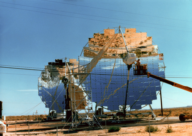 A view of two 11-meter experimental parabolic dishes located at the Test Bed Concentrator Site, operated by the Jet Propulsion Laboratory. Each collector module is composed of many square reflectors that can be rearranged and redirected to determine the optimum dish shape