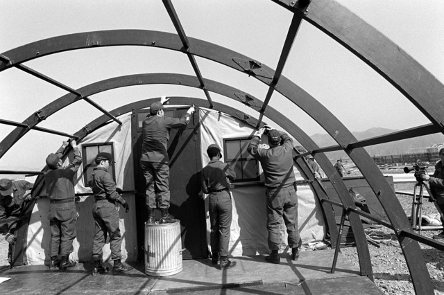 Airmen erect a dome tent in the tent city for Exercise Team Spirit '81. The airmen are from the 655th Tactical Field Hospital Squadron