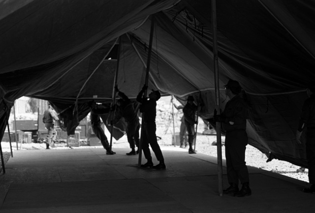 Airmen erect a tent in the tent city for Exercise Team Spirit '81. The airmen are from the 655th Tactical Field Hospital Squadron