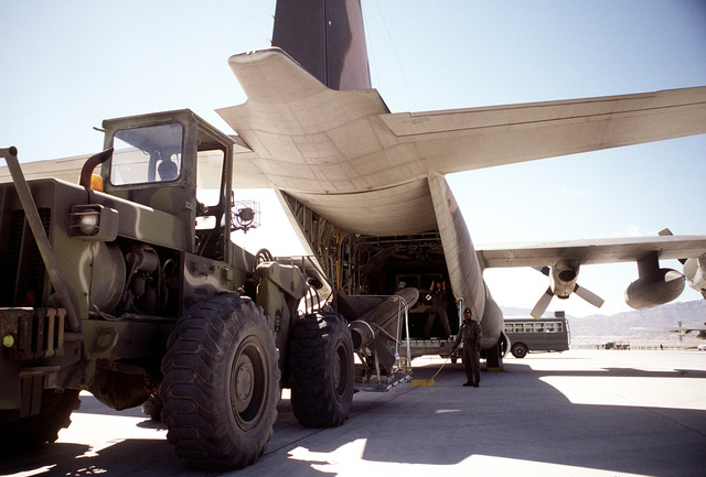 Airmen use a forklift to load an Army Hawk missile aboard a C-130 Hercules aircraft during exercise Border Star '81