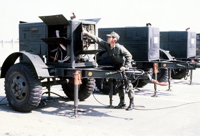 AMN John T. Acol examines circuitry in the EMU-19 power generator on a TSC-15 communication site during exercise Team Spirit '81