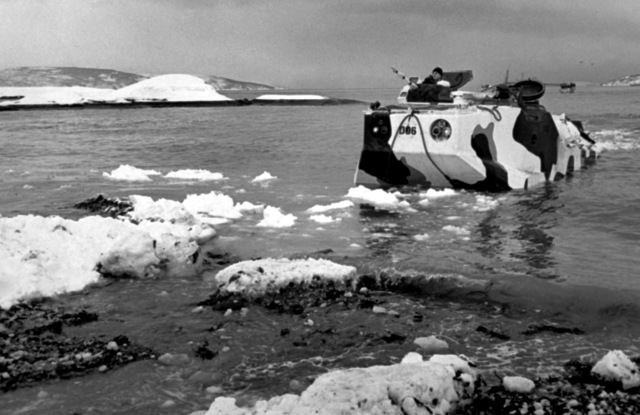 An amphibious armored personnel carrier lands on Kjerkevik Beach during the NATO exercise Cold Winter (COLDEX-FLOTEX '81). The exercise is intended to test all phases of amphibious operations in sub-freezing weather