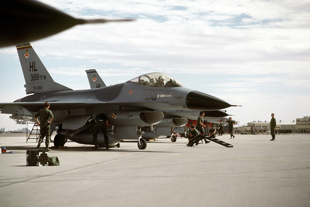 Ground crewmen prepare to marshal an F-16A Fighting Falcon aircraft out of a ramp area during exercise Border Star '81. The aircraft is assigned to the 34th Tactical Fighter Squadron, 388th Tactical Fighter Wing