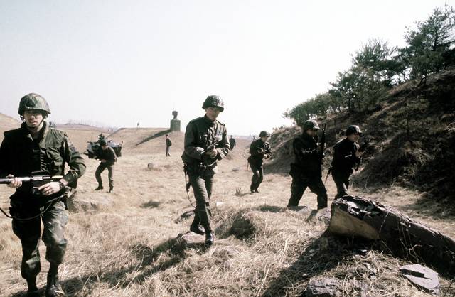 Korean and United States Air Force security policemen participate in joint maneuvers during exercise Team Spirit '81